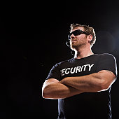 Security guard standing with arms crossed