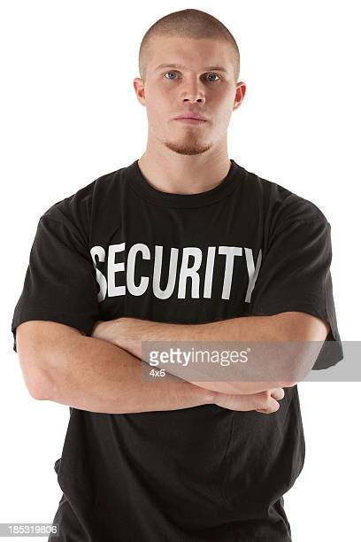 Security guard standing with his arms crossed