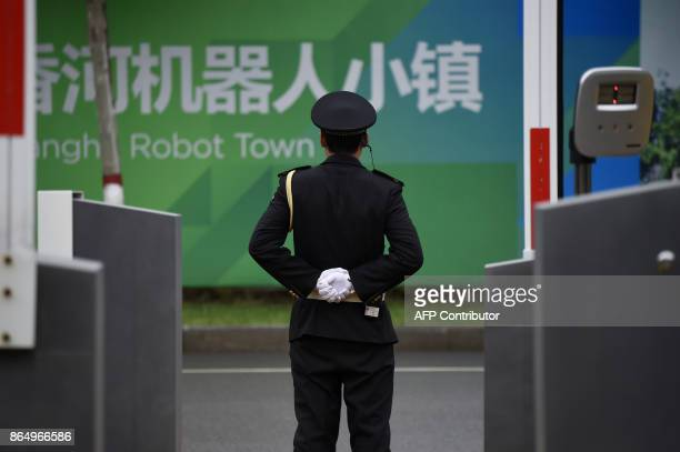 A security guard stands at the entrance of Xianghe Robot Industry Port during a tour arranged by the press center for the 19th Communist Party...