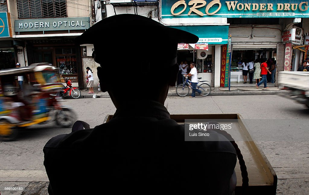 CITY PHILIPPINES – JULY 21 2009 A security guard stands at the entrance to a business in downtown Zamboanga City Philippines a flash point in a...