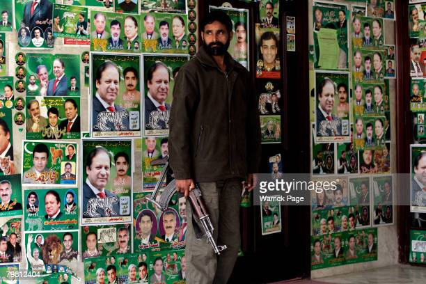A security guard stands his post at the PMLN secretariat before former prime minister Nawaz Sharif gives a press conference February 17 2008 in...