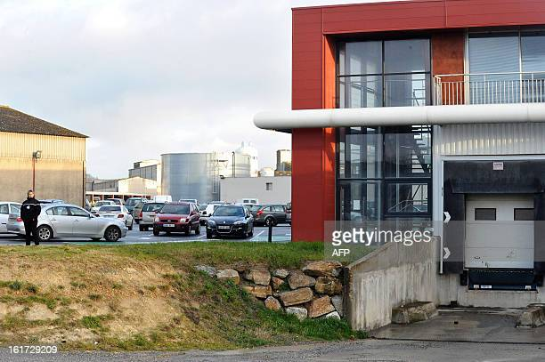 A security guard stands in a parking lot at the headquarters of French meat supplier Spanghero in Castelnaudary southern France on February 15 2013...