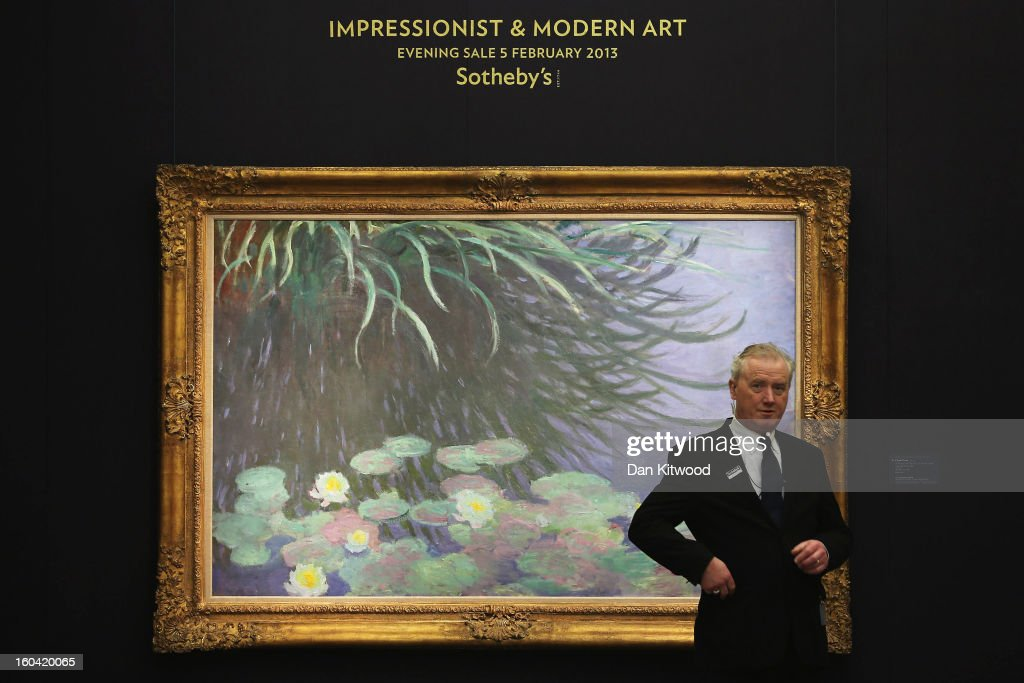 A security guard stands in front of a painting by Claude Monet entitled 'Nympheas avec reflects de hautes herbes,' on January 31, 2013 in London, England. The piece makes up a selection of works by artists including Monet, Miro, Picasso and Richter and is estimated to sell for between 12-18 Million GBP at auction in the 'Impressionist and Modern Art' evening sale at Sotheby's auction house on February 5, 2013.