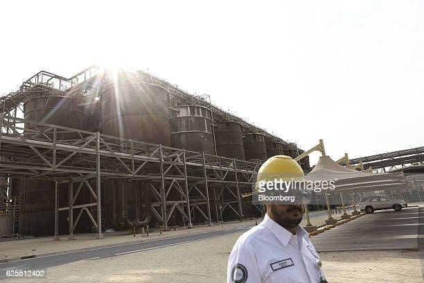 A security guard stands in front of storage tanks at the aluminium processing plant at the Ras Al Khair Industrial City operated by the Saudi Arabian...