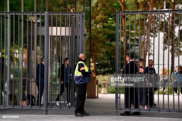A security guard stands in front of the BEIN's Paris offices in BoulogneBillancourt near Paris on October 12 during a raid by French authorities...