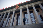 A security guard stands in front of The Great Hall of the People before the upcoming opening sessions of the Chinese People's Political Consultative...