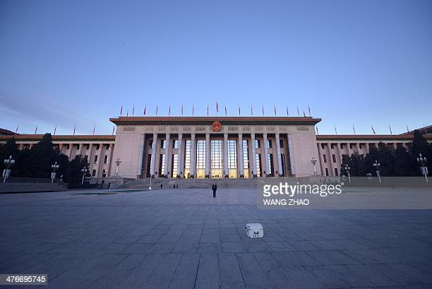 A security guard stands in front of the Great Hall of the People before the opening session of the 12th National People's Congress in Beijing on...