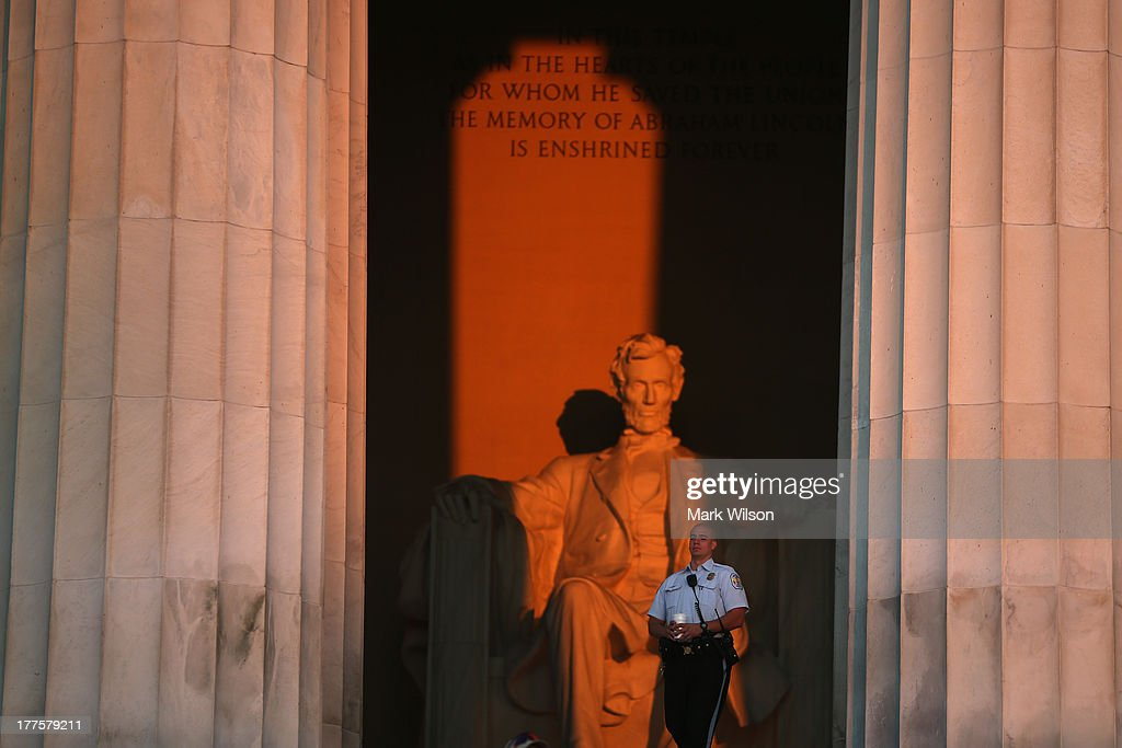 A security guard stands in front of the Lincoln Memorial as people gather to celebrate the 50th anniversary of the March on Washington and Dr. Martin Luther King, Jr.'s 'I have a Dream' speech on the National Mall on August 24, 2013 in Washington, DC. The event included a commemorative march and rally along the historic route followed on August 28, 1963 and is being led by civil rights leader Al Sharpton and Martin Luther King III, King's oldest son.