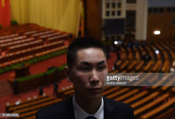 A security guard stands in the Great Hall of the People after the opening session of the National People's Congress in Beijing on March 5 2016 Chinas...