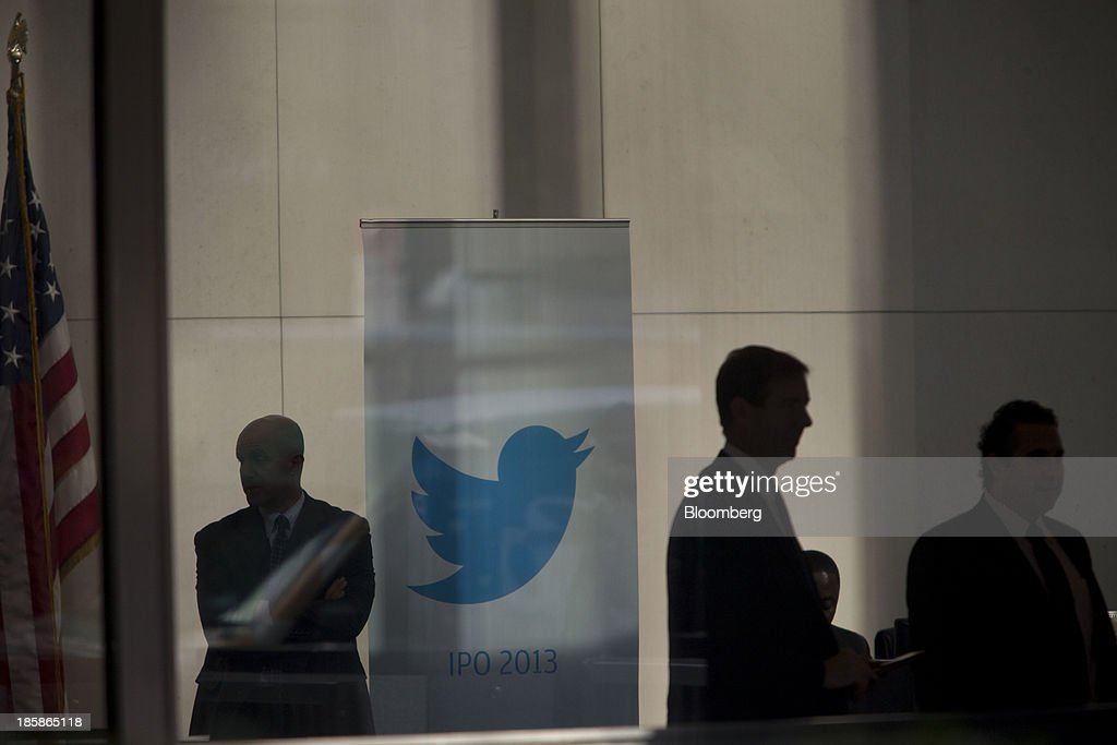 A security guard stands next to the Twitter Inc. logo displayed in the lobby of JPMorgan Chase & Co. headquarters in New York, U.S., on Friday, Oct. 25, 2013. Twitter Inc. will make the case to potential investors in its initial public offering that it needs to keep spending to grow, and profit will come once it can reap the benefits of those investments. Photographer: Scott Eells/Bloomberg via Getty Images