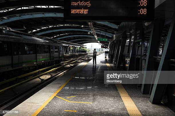 A security guard stands on a platform at the Srirampura metro station operated by Bangalore Metro Rail Corp in Bengaluru India on Sunday May 3 2015...