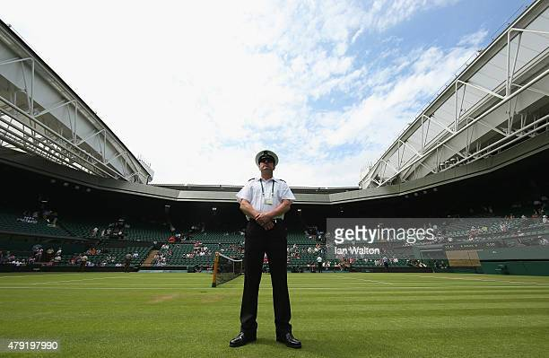 A security guard stands on Centre Court ahead of day four of the Wimbledon Lawn Tennis Championships at the All England Lawn Tennis and Croquet Club...