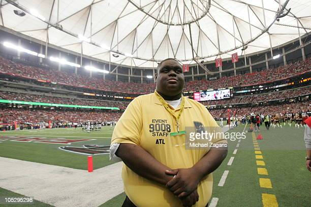 A security guard stands on the field during the game between the San Francisco 49ers and the Atlanta Falcons at the Georgia Dome on October 3 2010 in...