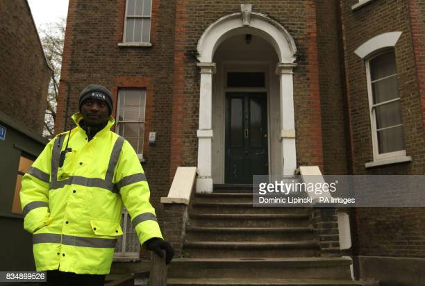 A security guard stands outside 94 Dalston Lane Hackney London which contains the workshop of drum maker Fernando Gomez who died after exposure to...