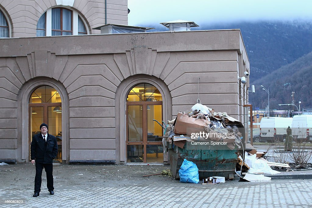 A security guard stands outside an unfinished hotel at the Rosa Khutor Mountain Cluster village ahead of the Sochi 2014 Winter Olympics on January 31, 2014 in Rosa Khutor, Sochi.