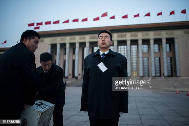 A security guard stands outside the Great Hall of the People in Beijing before the opening ceremony of the National People's Congress on March 5 2016...