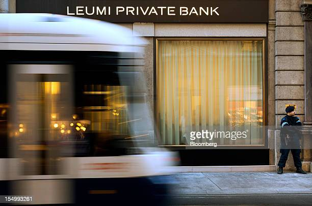 A security guard stands outside the Leumi Private bank a subsidiary of Bank Leumi LeIsrael in Geneva Switzerland on Monday Oct 29 2012 Geneva's banks...