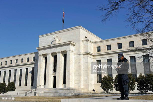 A security guard stands outside the US Federal Reserve Building in Washington DC US on Thursday March 5 2009 The Federal Reserve Board of Governors...