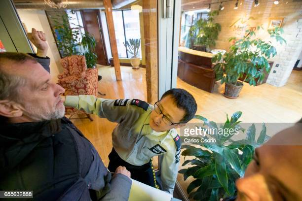 TORONTO ON MARCH A security guard stops Steve Love from knocking on the glass of the Metcap Living offices Tenants from Metcap buildings tried...