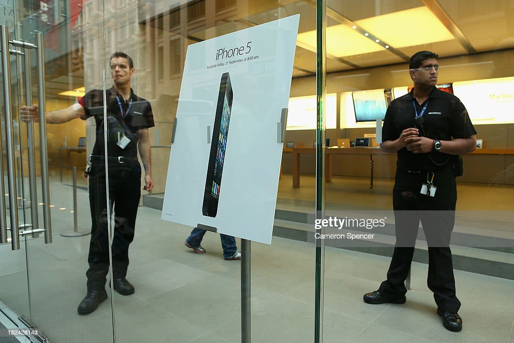 Security guard the entrance of the Apple flagship store on George street ahead of the iPhone 5 smartphone release on September 21, 2012 in Sydney, Australia. Australian Apple stores are the first in the world to receive and sell the new iPhone 5 handsets.