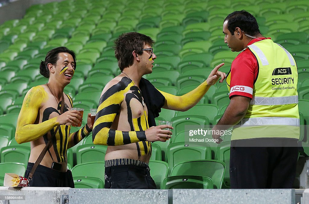 A security guard tries to throw two Wellington Phoenix fans out after the round 15 A-League match between the Melbourne Victory and Wellington Phoenix at AAMI Park on January 5, 2013 in Melbourne, Australia.