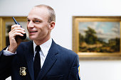 Security Guard Using Walkie-talkie at Art Gallery