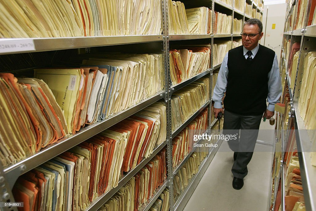 A security guard walks among files in the massive archives of the former Stasi, the secret police of the former East Germany January 13, 2005 in Berlin, Germany. Saturday, January 15, will mark the 15th anniversary of the storming of Stasi headquarters in Berlin by citizens in 1990, when the communist East German regime fell. The Stasi kept detailed records on millions of East Germans in a staggering volume of documents, most of which survive in today's archive. Over 90,000 people still apply evey year to see the files the Stasi kept on them.