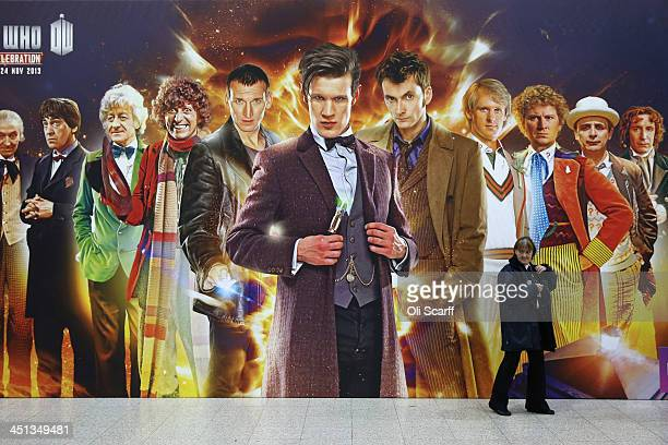 A security guard walks past a giant Doctor Who poster at the 'Doctor Who 50th Celebration' event in the ExCeL centre on November 22 2013 in London...