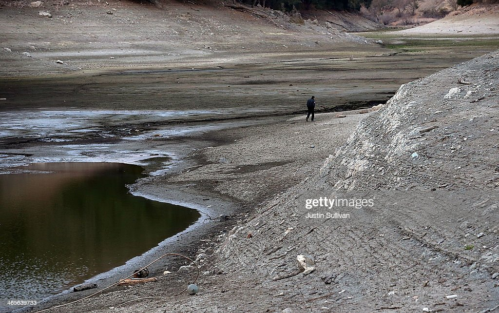 A security guard walks the perimeter of the Almaden Reservoir on January 28 2014 in San Jose California Now in its third straight year of drought...