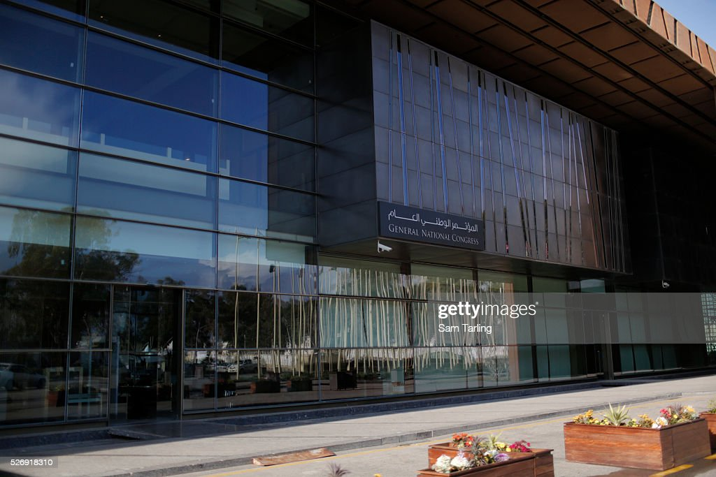 A security guard walks toward the Libyan General National Congress in Tripoli on March 10 2015 The seat of power in western Libya the GNC...