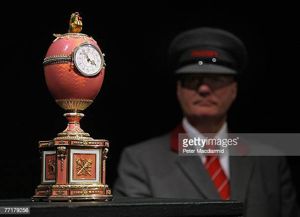 A security guard watches over the recently unveiled Rothschild Faberge Egg is displayed at Christie's auctioneers on October 4 2007 in London The...