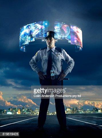 Security guard watching virtual screens outdoors
