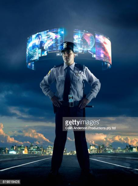 Security guard watching virtual screens outdoors