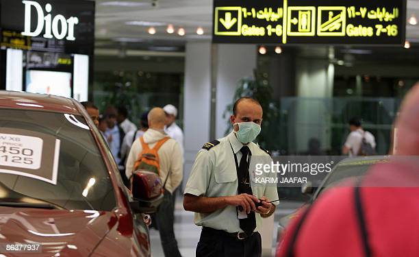 A security guard wears a protective mask at the airport in Doha on May 5 2009 The number of swine flu victims topped the 1000 mark on May 4 as the...