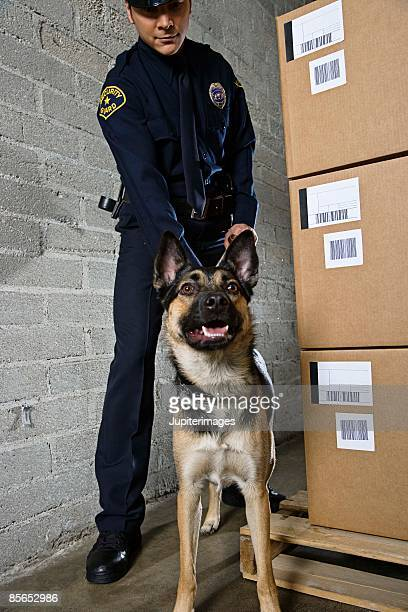 Security guard with dog in warehouse