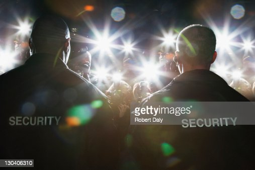 Security guards blocking paparazzi