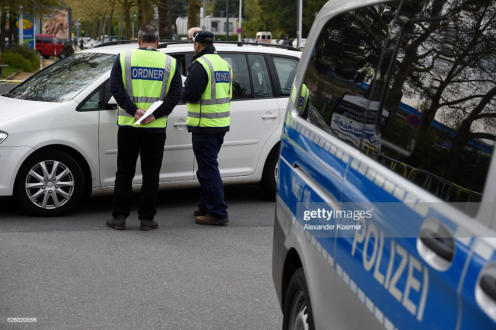 Security guards check a vehicle prior the the Bundesliga Match of SV Darmstadt 98 and Eintracht Frankfurt at Merck-Stadion am Bollenfalltor on April 30, 2016 in Darmstadt, Germany. Fans of Eintracht Frankfurt burnt scarves and Banner during the first leg game in December 2015 of SV Darmstadt 98. The city of Darmstadt has ordered a ban of staying for fans of Eintracht Frankfurt for 36 hours inside the city centre and the stadium.