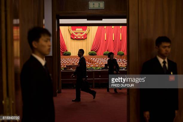 Security guards check an the entrance during the third plenary session of the National People's Congress at the Great Hall of the People in Beijing...