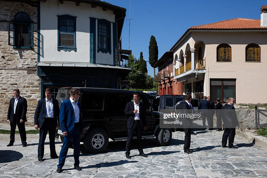 Security guards escort the car of Vladimir Putin, Russia's president, during a visit to Mount Athos, Greece, on Saturday, May 28, 2016. Putin arrived at the northern Greek peninsula of Mount Athos, on a visit to the autonomous Orthodox Christian monastic community. Photographer: Konstantinos Tsakalidis/Bloomberg via Getty Images