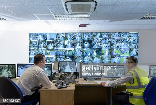 Security Guard In Security Control Room With Video Wall Stock