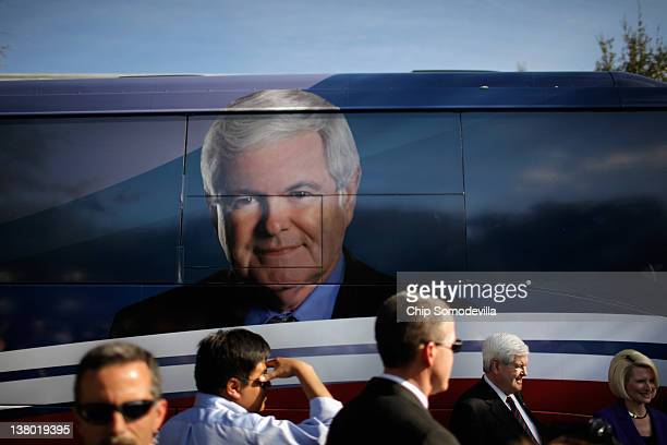 Security guards keep a close eye on the crowd as Republican presidential candidate and former Speaker of the House Newt Gingrich and his wife...