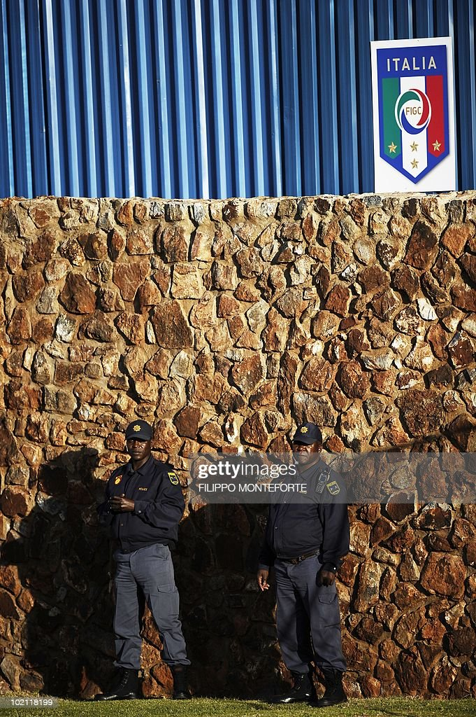 Security guards keep watch while Italy#s football squad trains at Irene's Southdowns College, south of Pretoria on June 15, 2010. The 2010 World Cup hosted by South Africa continues through July 11. AFP PHOTO/Filippo MONTEFORTE