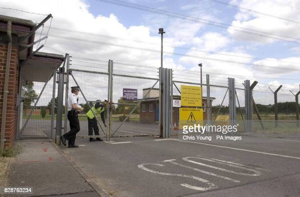 Security guards lock the gates of 'Site A' the former MoD site near Bicester Oxfordshire * Deputy Prime Minister John Prescott has granted the Home...