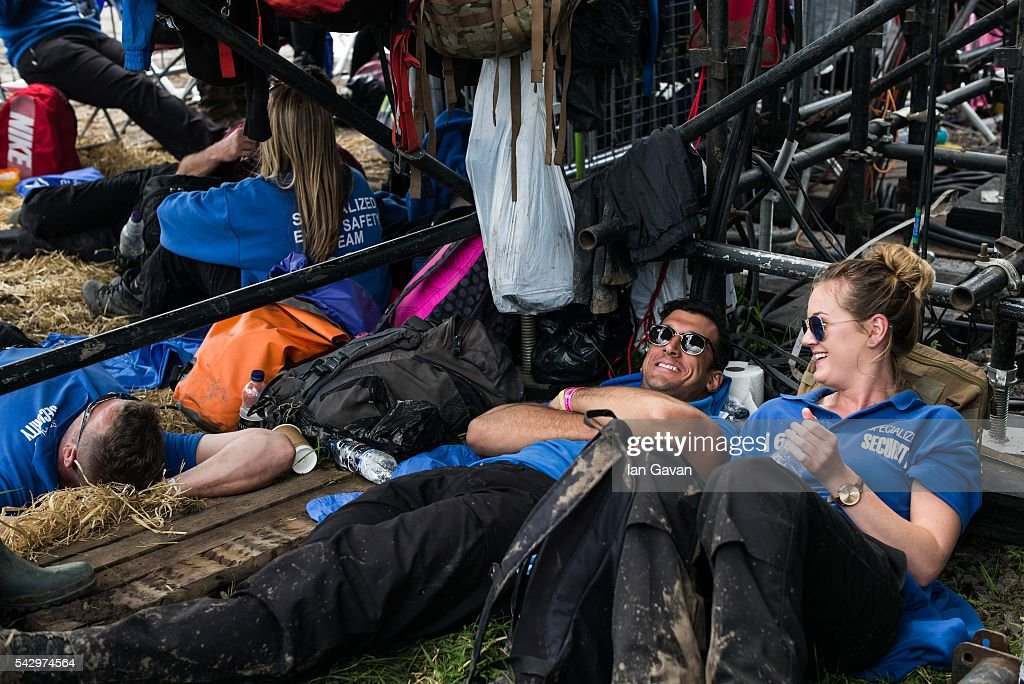 Security guards rest under the Pyramid Stage on day 2 of the Glastonbury Festival at Worthy Farm, Pilton on June 25, 2016 in Glastonbury, England. Now in its 46th year the festival is one largest music festivals in the world and this year features headline acts Muse, Adele and Coldplay. The Festival, which Michael Eavis started in 1970 when several hundred hippies paid just £1, now attracts more than 175,000 people.