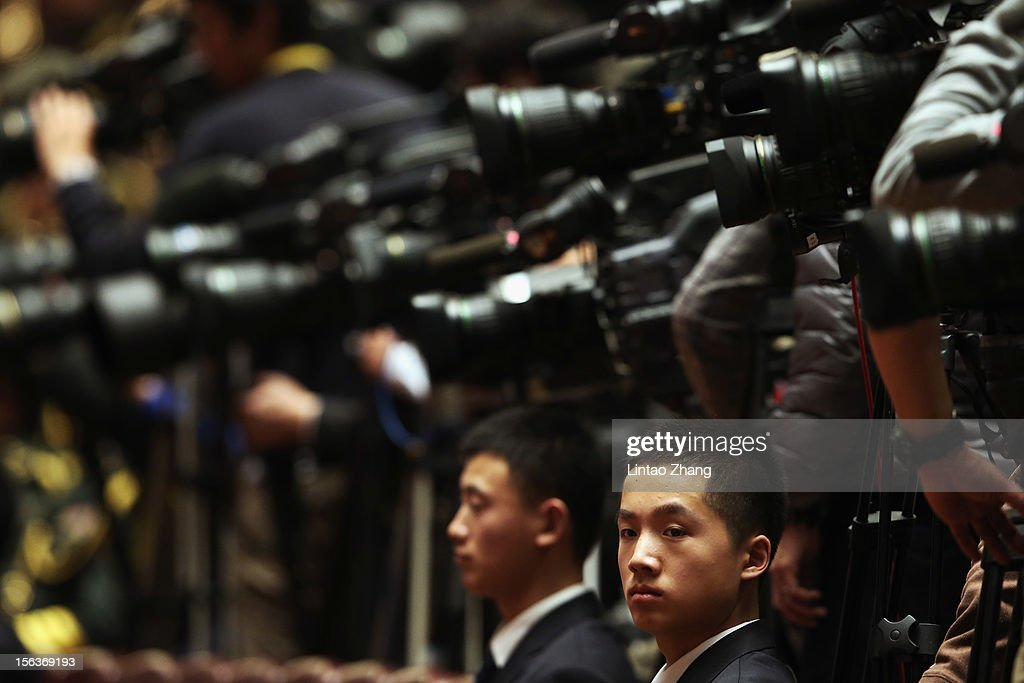 Security guards sit in front of the media during the closing of the 18th Communist Party Congress at the Great Hall of the People on November 14, 2012 in Beijing, China. The Communist Party Congress will convene from November 8-14 and will determine the party's next leaders.