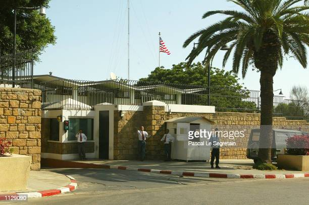 Security guards stand at the entrance of the American Embassy July 10 2002 in Rabat Morocco US embassies around the world have been placed on high...