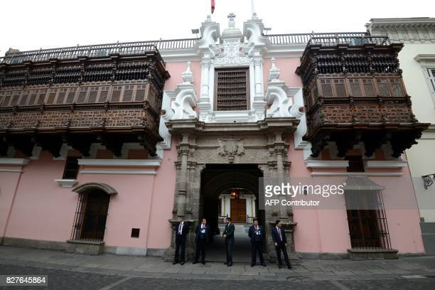 Security guards stand at the entrance of the Torre Tagle Palace in Lima where foreign ministers of at least 14 Latin American and Caribbean nations...