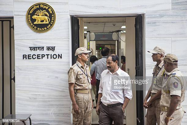 Security guards stand at the entrance to the reception of the Reserve Bank of India in Mumbai India on Tuesday June 7 2016 Raghuram Rajan governor of...