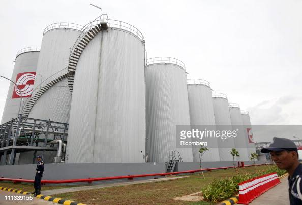 Security guards stand by the storage tanks at the PT Sinar Mas Agro Resources and Technology Tbk palm oil refinery in Marunda Indonesia on Wednesday...