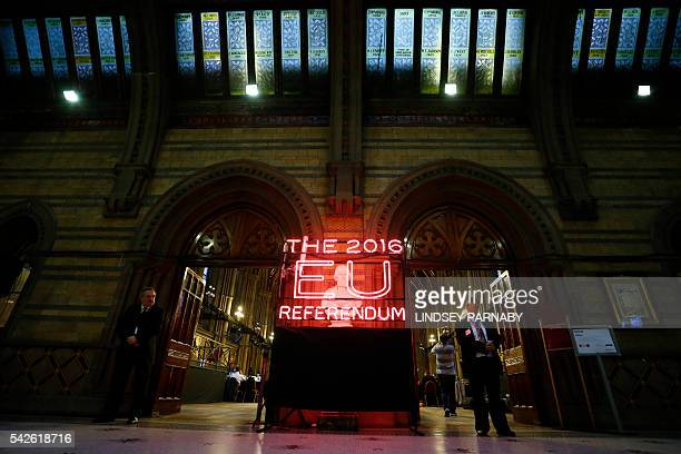 TOPSHOT Security guards stand guard at the doors of the announcement hall in Manchester Town Hall northwest England on June 23 2016 where the final...